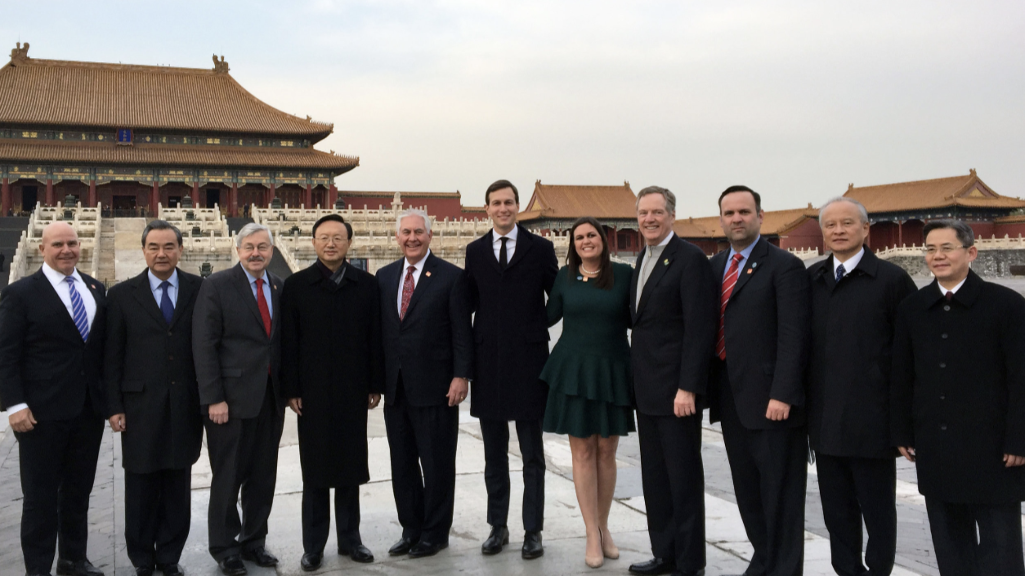 Senior U.S. and Chinese government officials pose for a photo in front of buildings in the Forbidden City, Beijing.