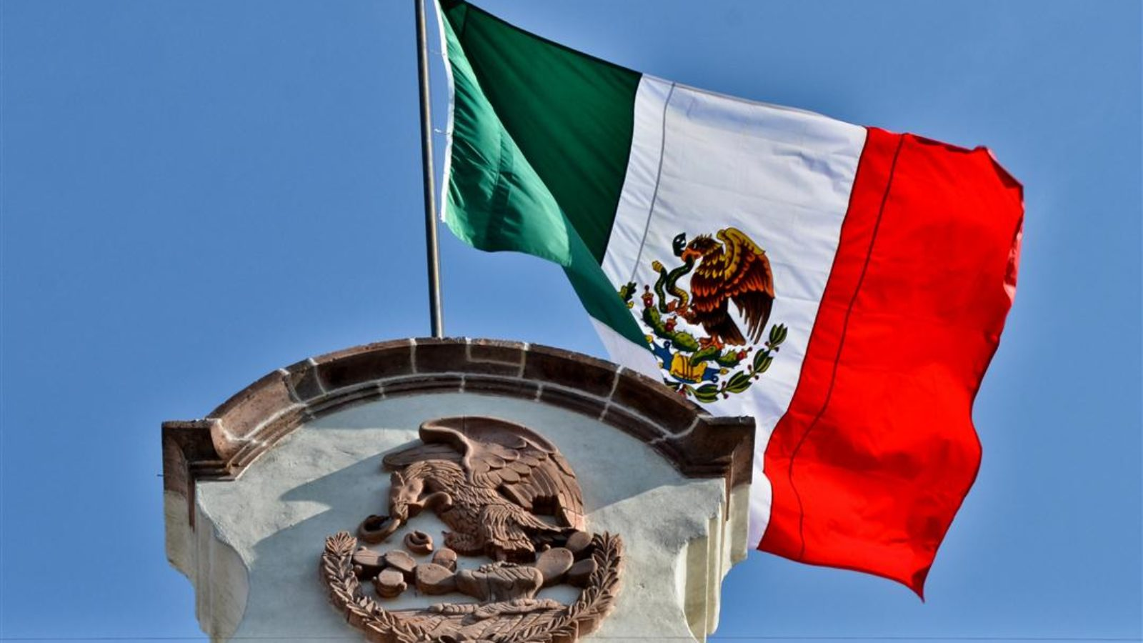 The Mexican flag on top of a building