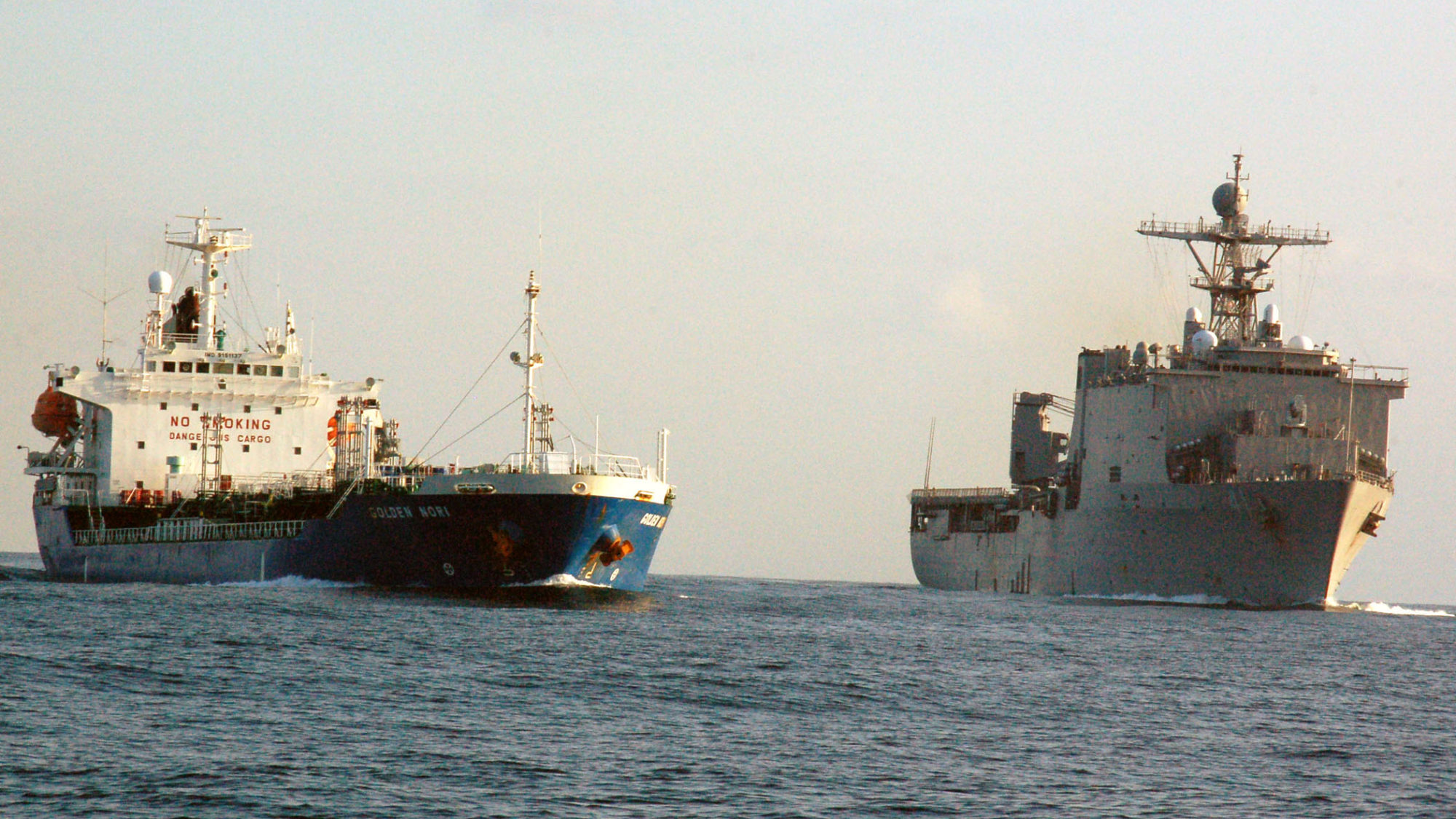 Two large US Navy ships on the sea