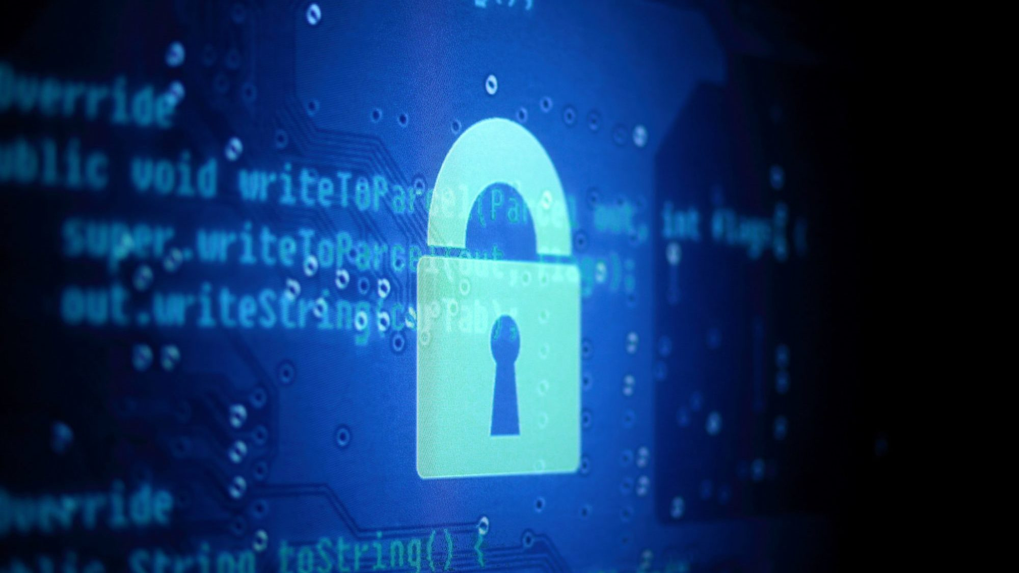 Glowing blue lock with computer code in the background