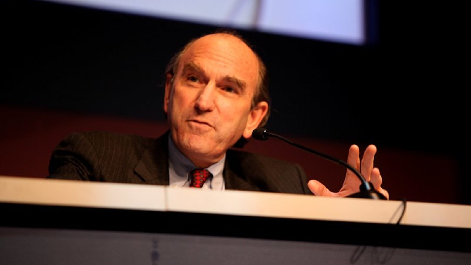 Elliot Abrams speaks into a microphone.