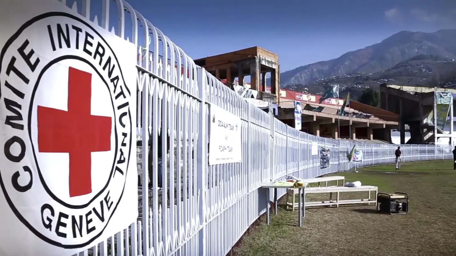 The International Committee of the Red Cross logo on a white fence.