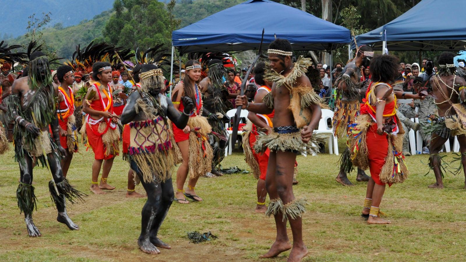 Men and women dancing in Papua New Guinea