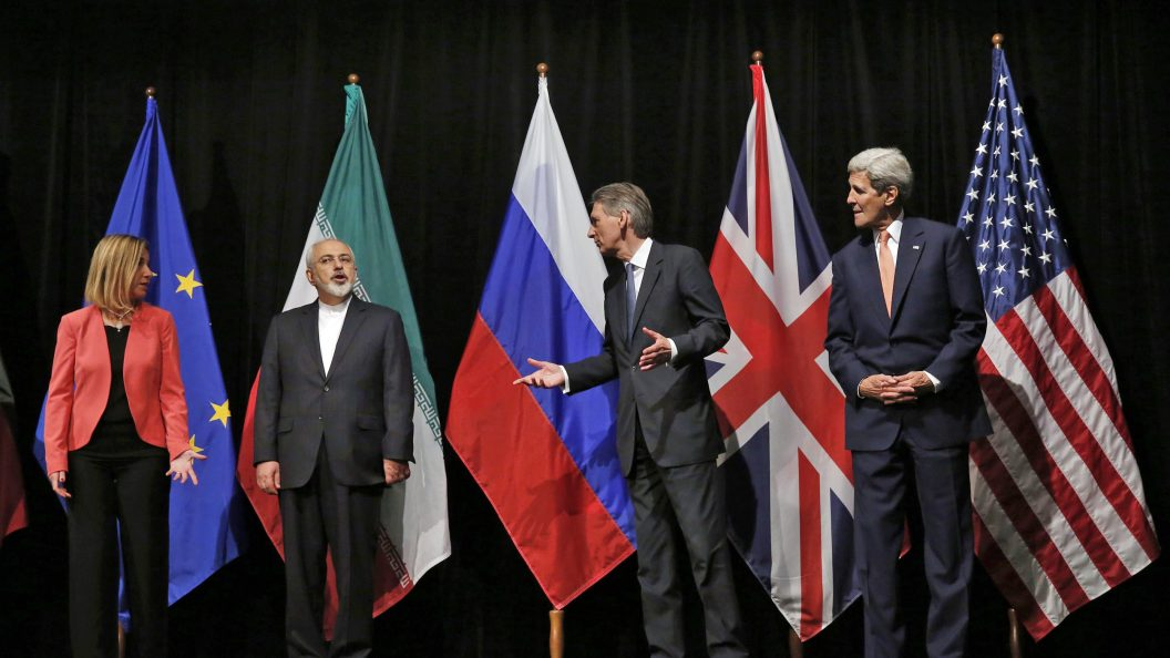 Diplomats from the U.S., UK, EU, and Iran standing side-by-side.