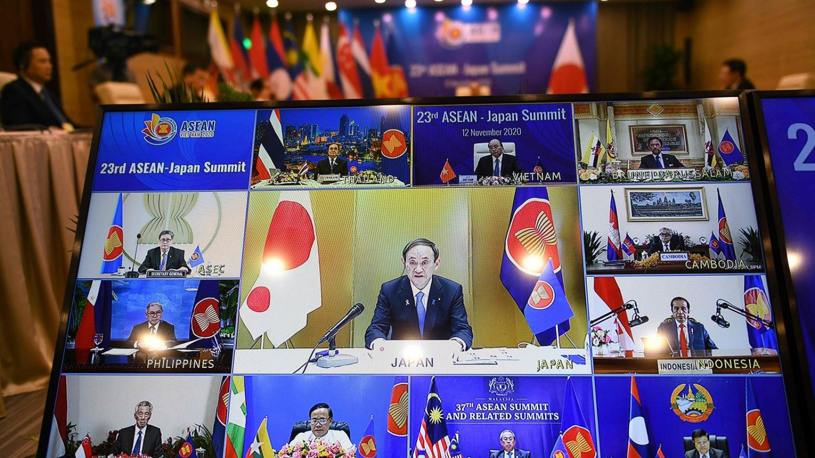 Prime Minister Suga and ASEAN leaders shown on digital monitor.