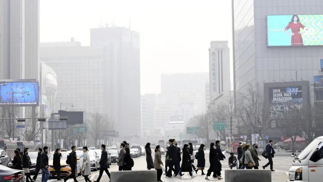South Korean citizens cross the street.