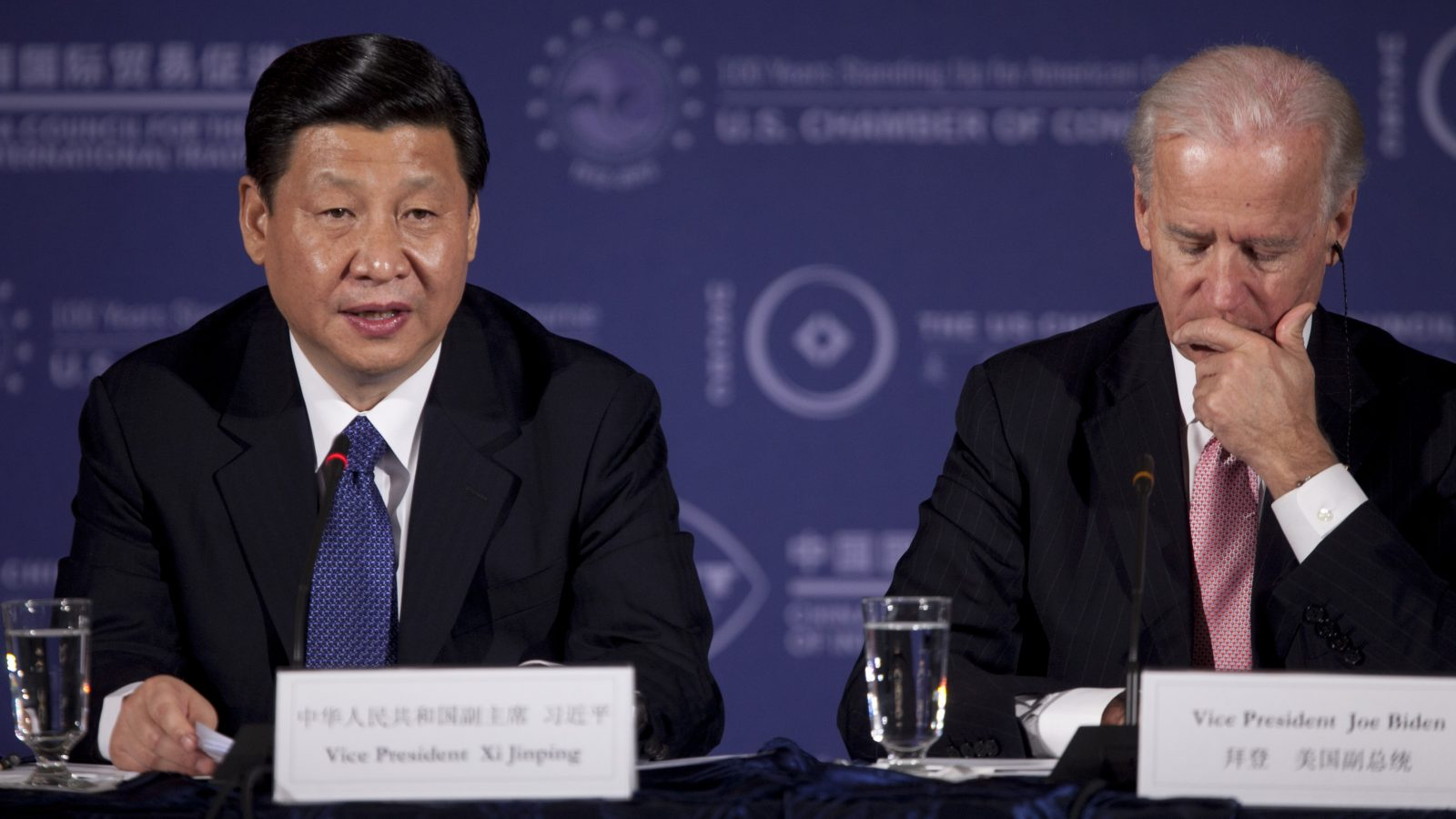 Biden sits next to Xi.