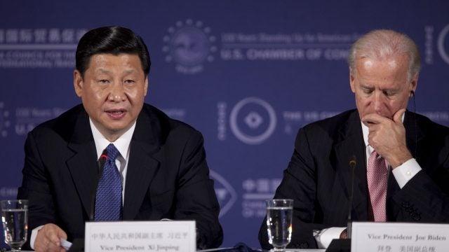 Biden sits next to Xi.