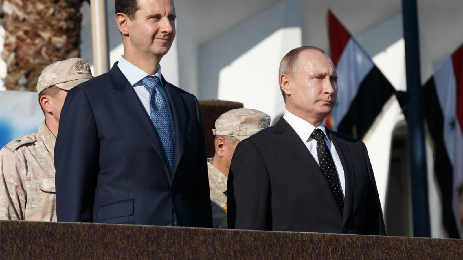 Putin and Syrian president stands