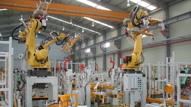 Manufacturing equipment in a warehouse