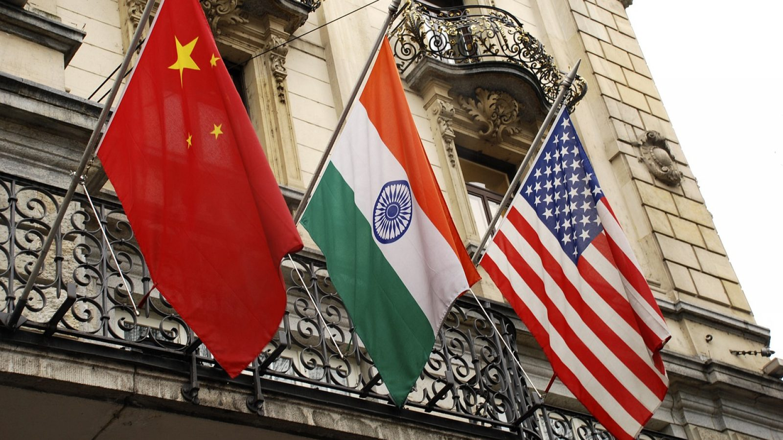 From left to right: the flag of China, India, and the United States