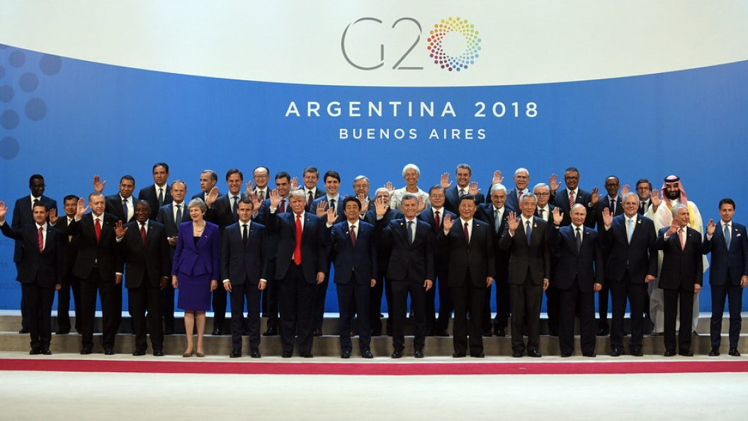 world leaders stand together at the G20 conference